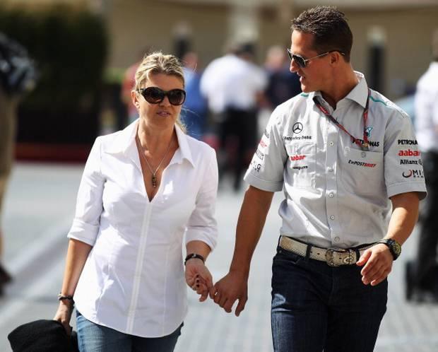 Michael Schumacher walks with his wife Corrina. Photo / Getty