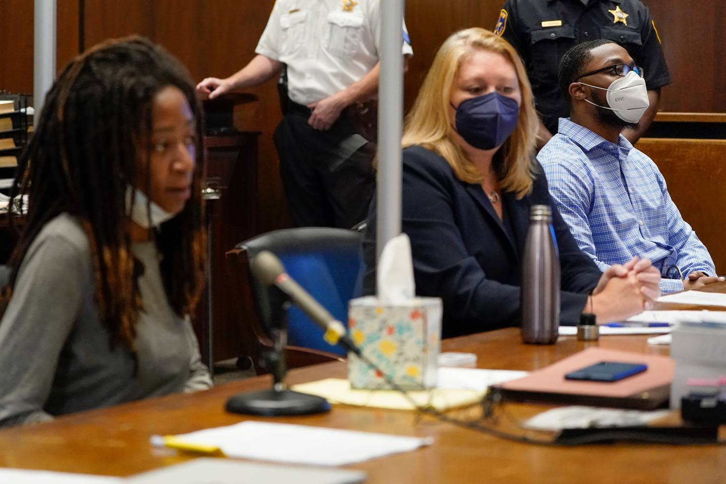 Tiffany Taylor, left, who survived an attack by Khalil Wheeler-Weaver, right, speaks during his sentencing. Photo / Seth Wenig, Pool via AP