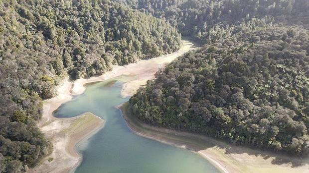 An aerial view of the shocking water level at Whau Valley Dam which will be shut down if insufficient rain fell in winter. Photo / Supplied