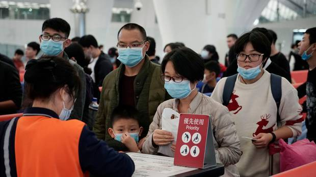 Chinese and Hong Kong residents are wearing masks in a bid to prevent themselves from picking up the deadly coronavirus. Photo / AP