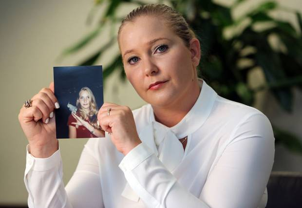 Virginia Roberts holds a photo of herself at age 16, when she says Palm Beach multimillionaire Jeffrey Epstein began abusing her sexually. Photo / Getty Images
