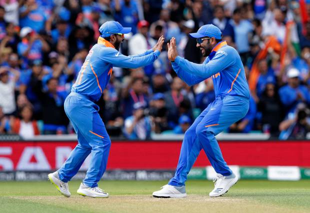 Kedar Jadhav and Rohit Sharma of India celebrate after taking the wicket of Aaron Finch of Australia. Photo / Getty