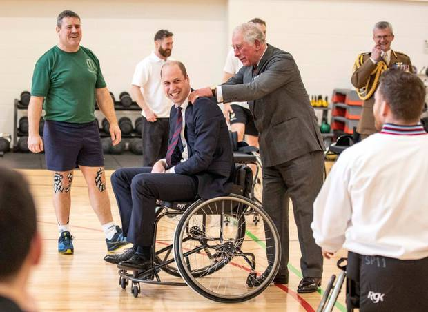 Prince Charles consoles William after missing a basket. Photo / Getty Images