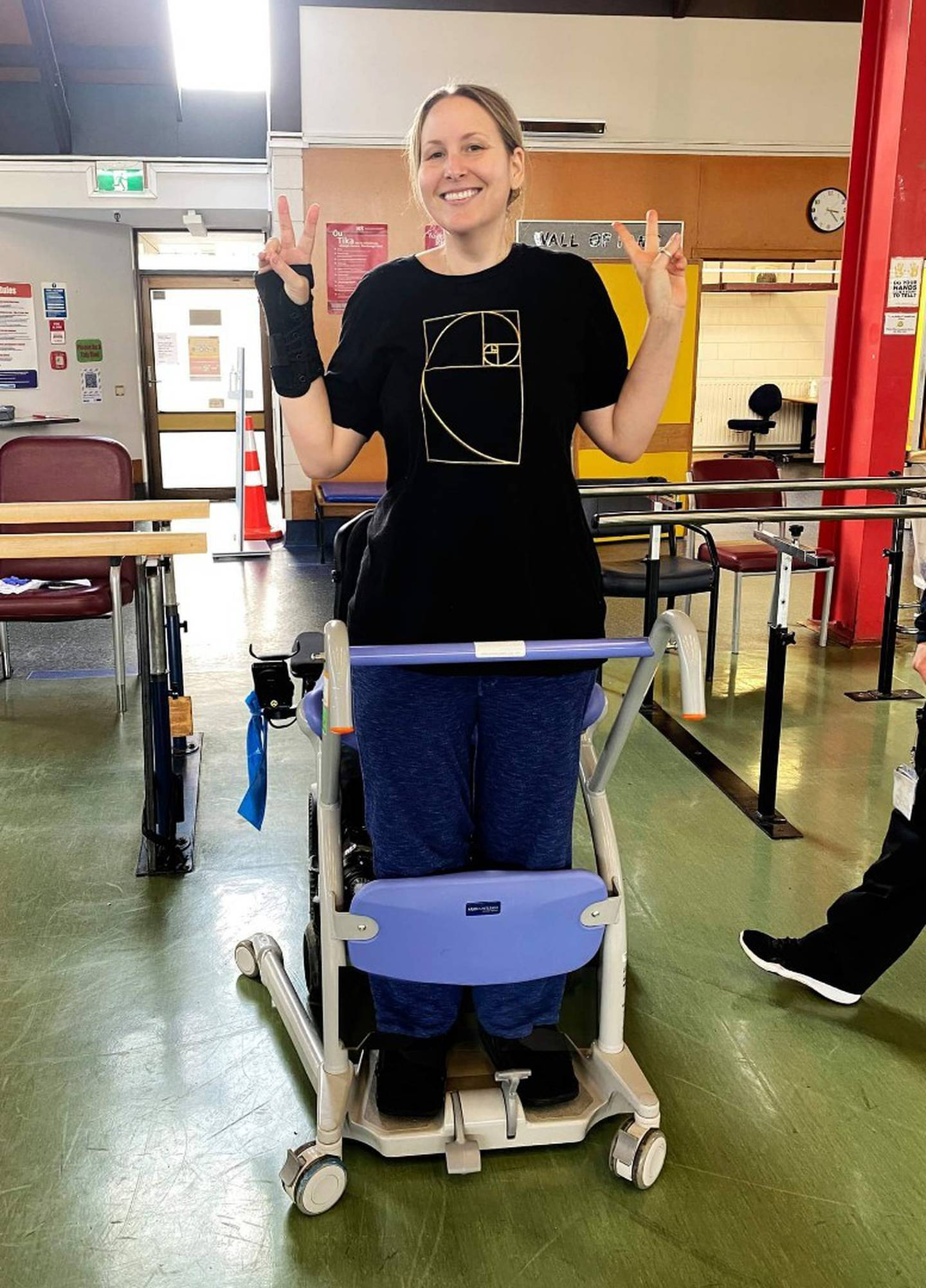 Rachel Jordan taking some of her first steps, three months after a near-fatal helicopter crash. Photo / Supplied