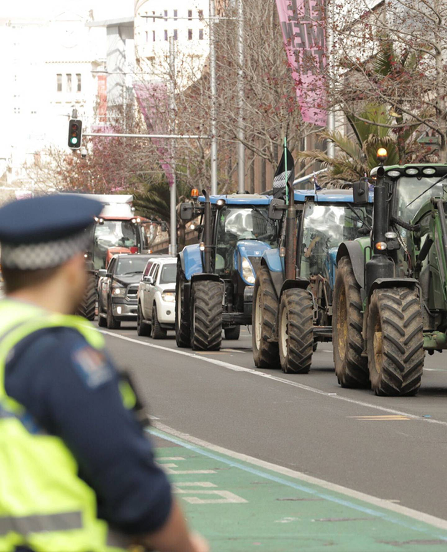 Tractors on Auckland's Queen St today. Photo / Greg Bowker