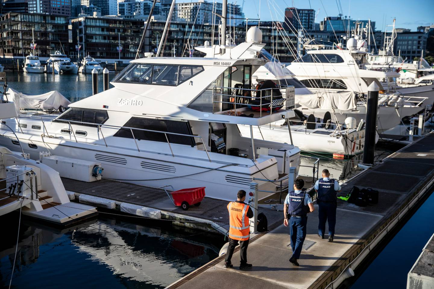 Police and maritime investigators at the Zefiro at Auckland's Viaduct Harbour this morning. Photo / Michael Craig