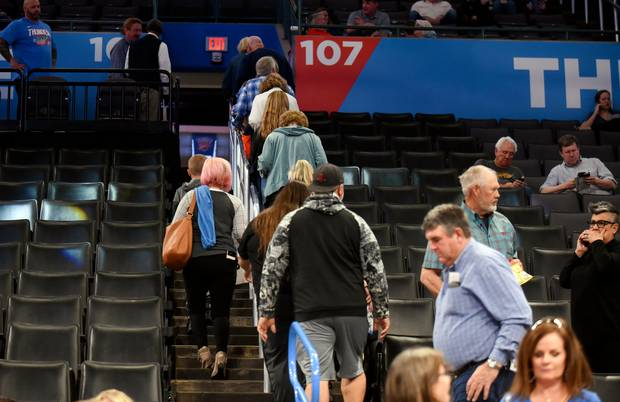 Basketball fans leave Chesapeake Energy Arena after it is announced that an NBA basketball game between Oklahoma City Thunder and Utah Jazz in Oklahoma City has been postponed. Photo / AP