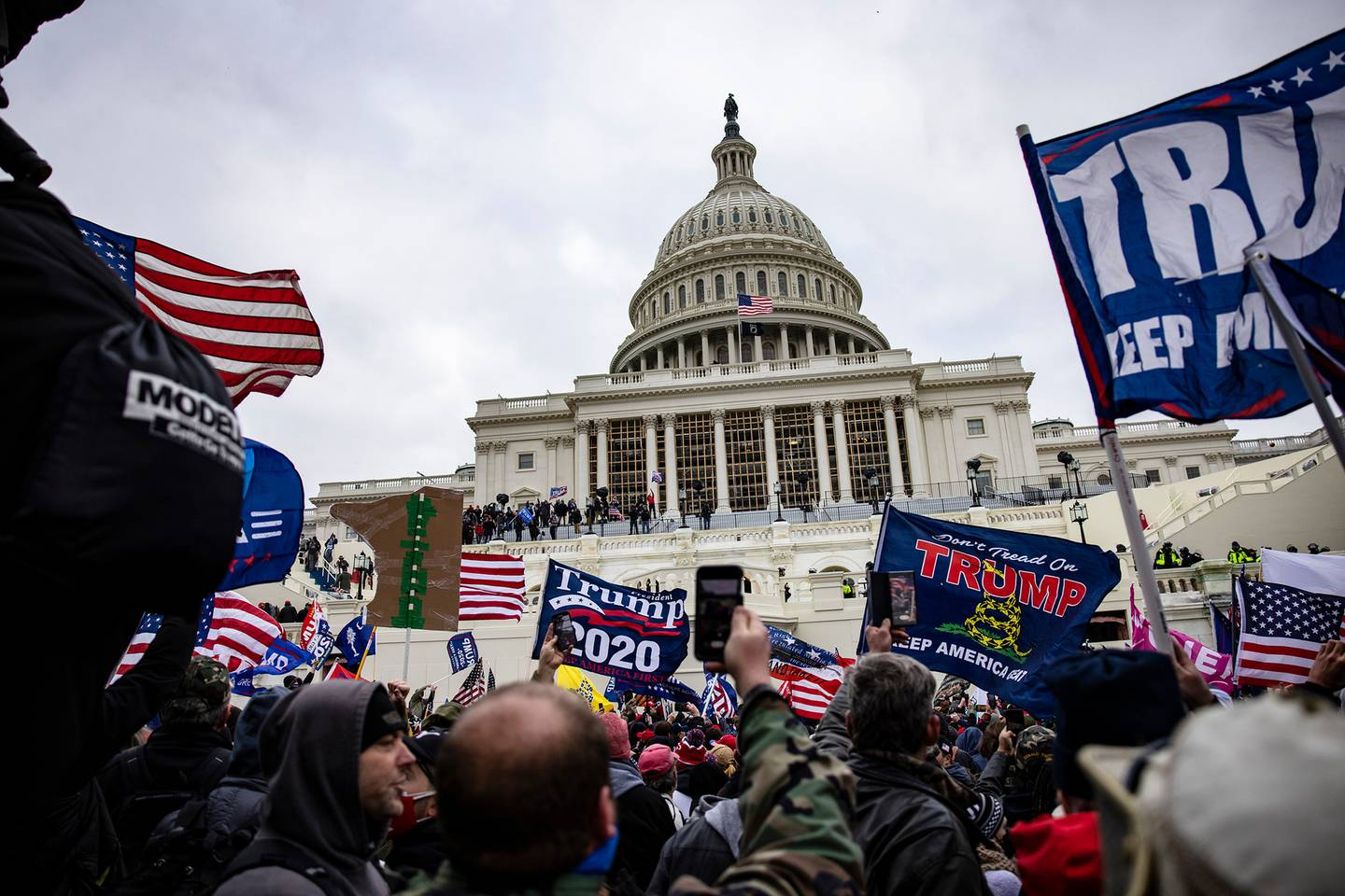 Pro-Trump protesters gather in front of the US Capitol Building on January 6 before a mob stormed the Capitol, breaking windows and clashing with police officers. Photo / Getty Images