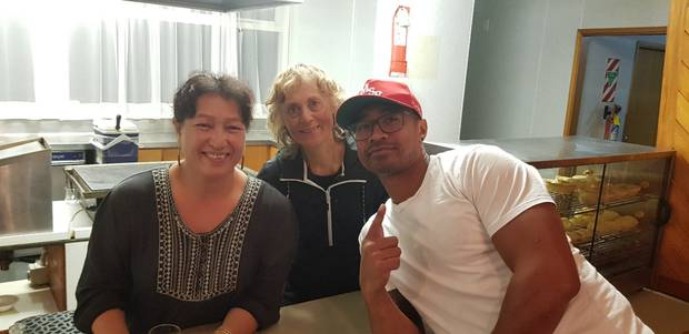 The late Pua Magasiva charming kitchen staff, Frances and Rosalie, at the Marist St Pats Rugby Club in Wellington during a recent visit. Photo / Supplied