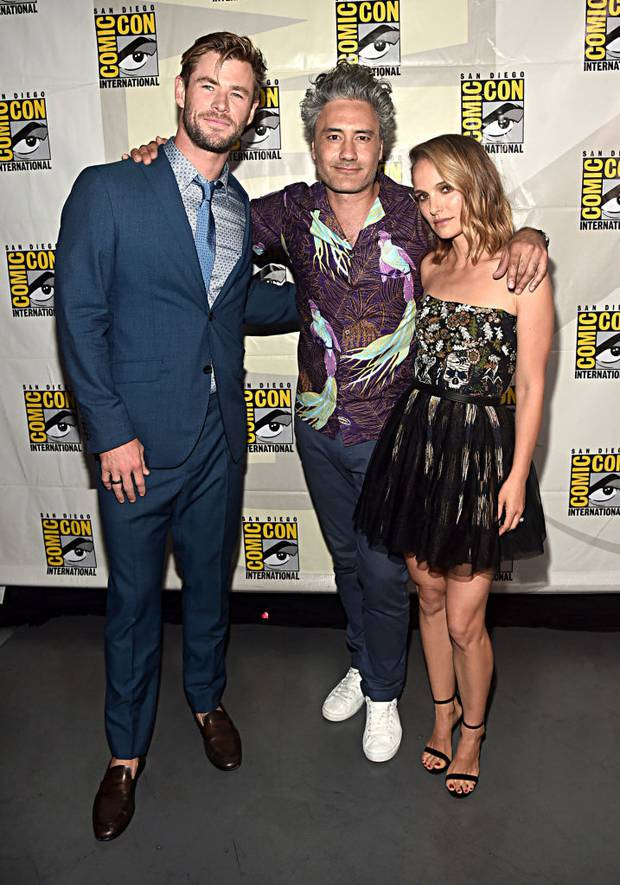 Sometimes one Thor's just not enough: Taika Waititi (centre) poses with Chris Hemsworth (Thor) and Natalie Portman (The Mighty Thor) at the San Diego Comic-Con International. Photo / Getty Images
