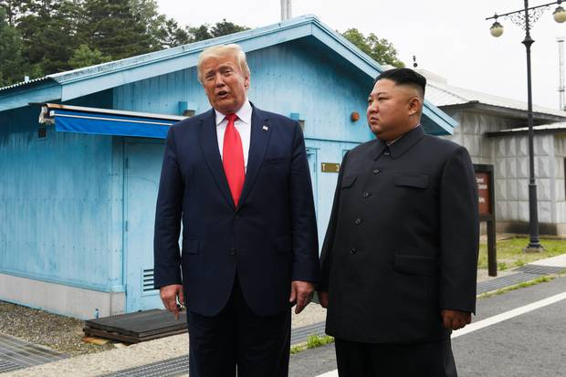 Donald Trump the first US leader to enter North Korean territory as he meets with Kim Jong Un