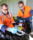 Northland Regional Council hazardous substances specialist James Mitchell, left, and Environmental Monitoring Officer Scott Lyon, take bore water samples at Ruakaka yesterday. Photo/NRC