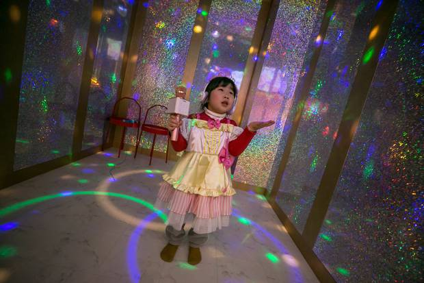 A young girl sings and dances inside a karaoke room at PriPara Kids Cafe. Photo / Jean Chung. Washington Post