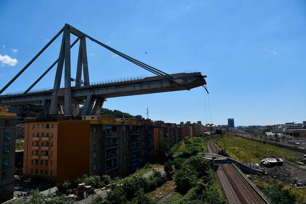 A view of the evacuated houses built under the remains part of the collapsed Morandi highway bridge, in Genoa, northern Italy. Photo / AP