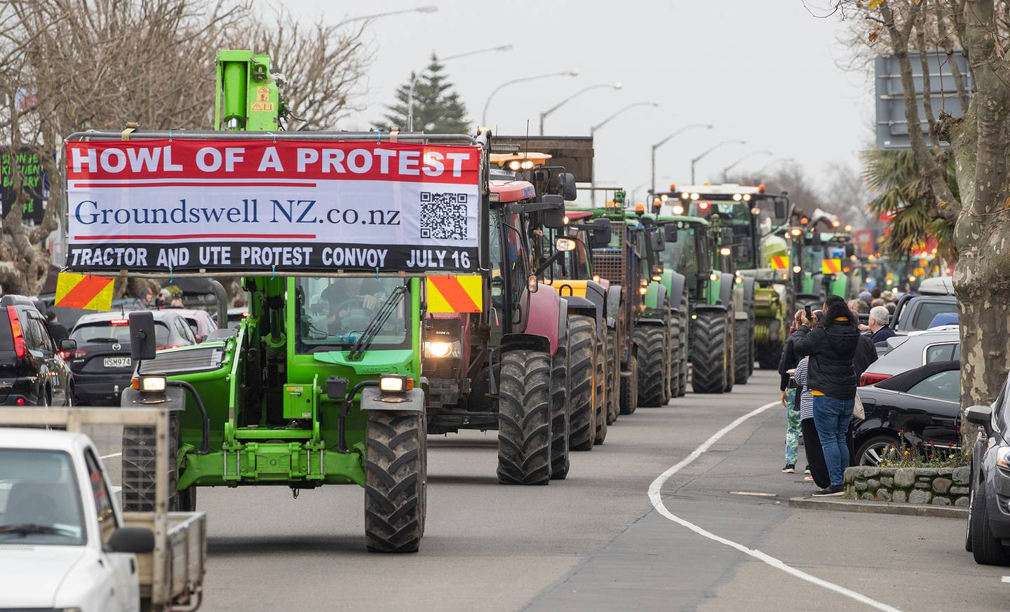 A large convoy of tractors, farm machinery and utes on Oxford Street, Levin. Photo / Mark Mitchell