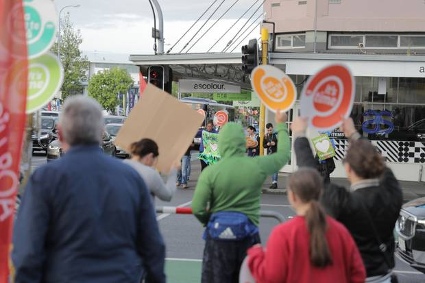 Striking primary school teachers protest in central Auckland this morning. Photo / Michael Craig