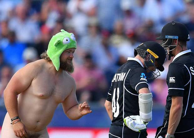A streaker approaches the New Zealand batsmen during their World Cup match against England. Photo /Getty