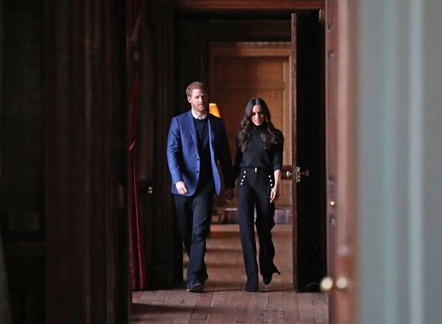 Prince Harry and Meghan Markle walk through the corridors of the Palace of Holyroodhouse. Photo / Getty Images