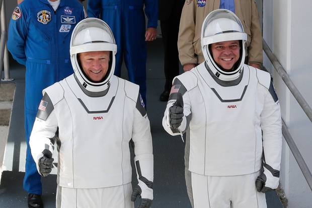 Nasa astronauts Douglas Hurley, left, and Robert Behnken on their way to Pad 39-A, at the Kennedy Space Centre in Cape Canaveral. Photo / AP