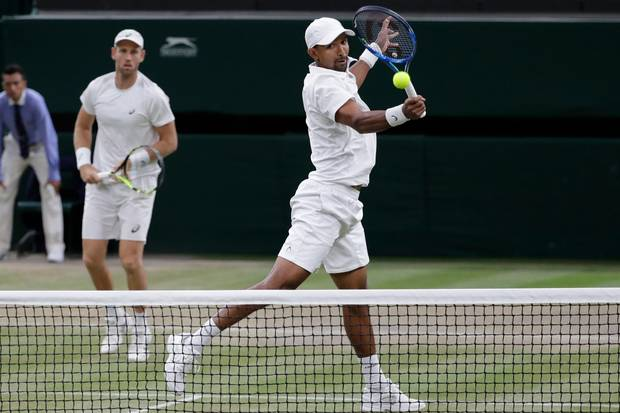 South Africa's Raven Klaasen, right, and New Zealand's Michael Venus return the ball to Mike Bryan and Jack Sock of the United States during their men's doubles final. Photo / AP.