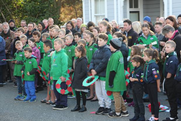 Manakau School pupils sing the national anthem at the Manakau Cenotaph, Anzac Day, 2018. Photo / supplied