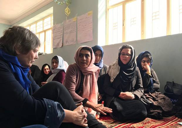 Helen Clark spends time with a women's empowerment group in Afghanistan set up by World Vision. Photo / World Vision