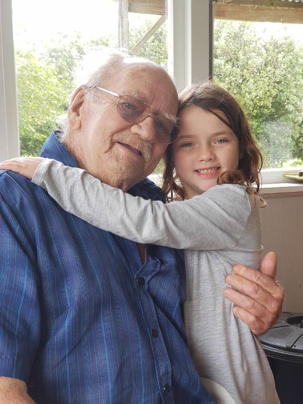 Richard Mackay, pictured with his granddaughter at his house in Tinopai near Dargaville, said he would believe Chorus' promises when he saw them.