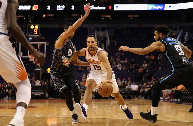Ryan Anderson of the Phoenix Suns in action against of Tai Wesley and Corey Webster of the Breakers. Photo / Getty