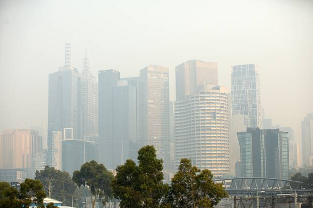 A general view of the city shrouded in smoke at Melbourne Park. Photo / Getty Images