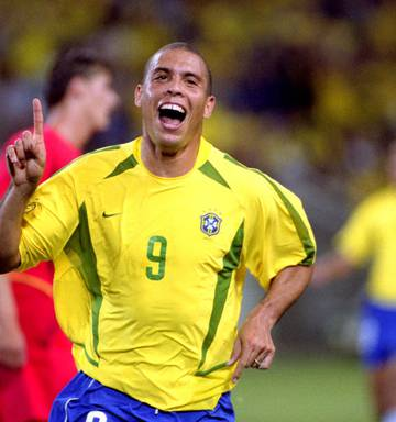 6222ac587 Photo Ronaldo celebrates after scoring a goal for Brazil during the 2002 Fifa  World Cup. Photo