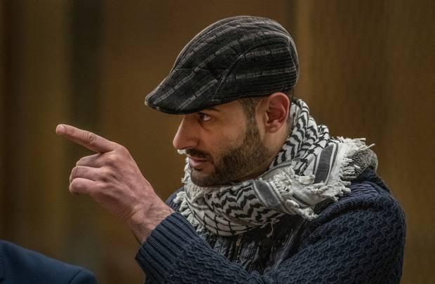 Khaled Majed Abd'el Rauf Alnobani points at Tarrant while giving his victim impact statement. Photo / Pool
