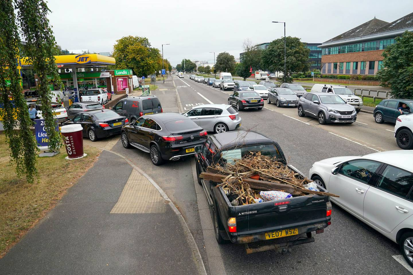 Cars queue outside a petrol station in Slough, England. Photo / AP