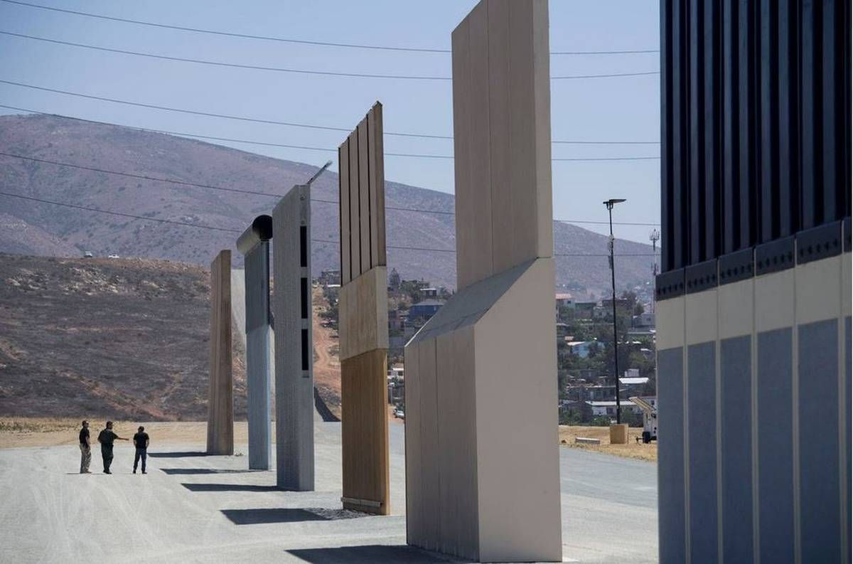 Trump wants his border barrier to be painted black with spikes. He has other ideas, too