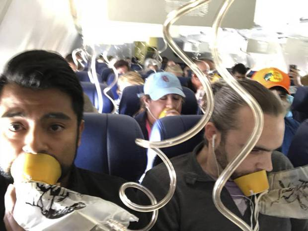 Marty Martinez left appears with other passengers after a jet engine blew out on the Southwest Airlines Boeing 737 plane
