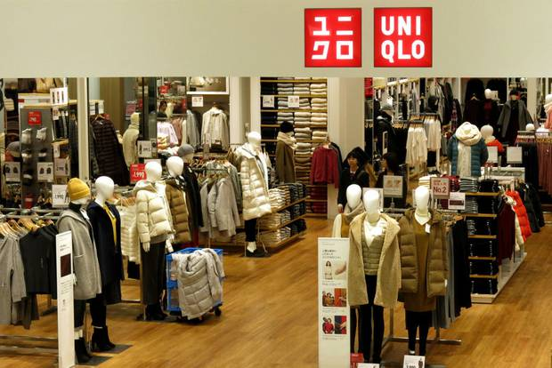 Shoppers look at items in a Uniqlo store in Tokyo, Japan. Photo / Getty Images