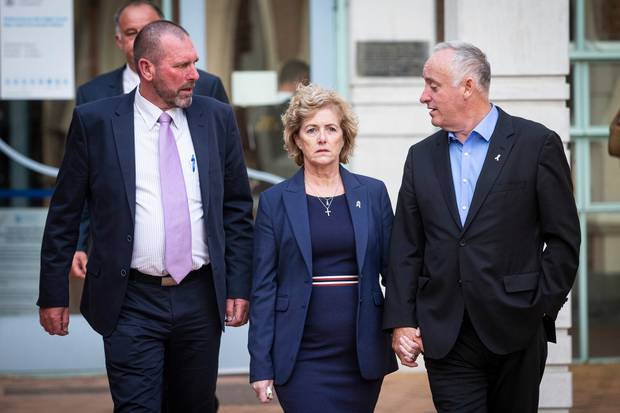 Grace Millane's parents Dave Gillian walk out from the Auckland High Court with Detective Inspector Scott Beard, left, after the jury delivered a murder verdict. Photo / Jason Oxenham