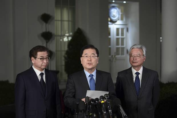 South Korean national security director Chung Eui-yong, centre, speaks to reporters at the White House in Washington. Intelligence chief Suh Hoon is at left. Photo / AP