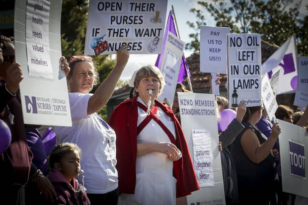 The nurses' chanting, whistling and singing prompted plenty of motorists to toot in support. Photo / Paul Taylor.