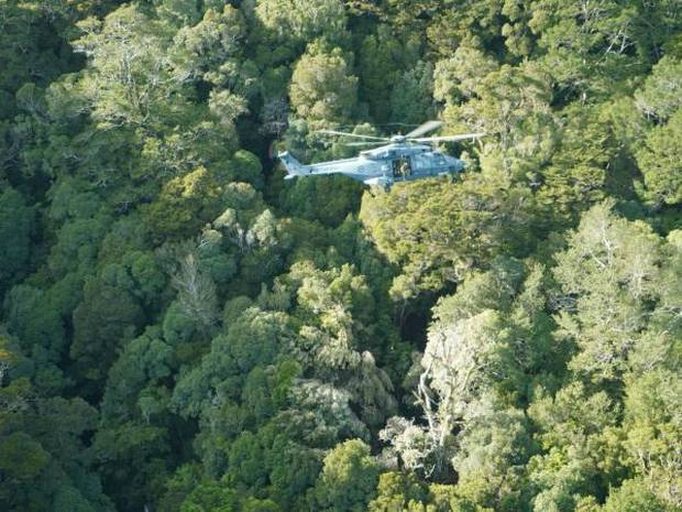 The chopper crew who managed to spot the pair in a small three metre clearing. Photo / Supplied