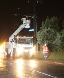 Power workers in Tiwha St, Rotorua as a storm hits the region. Photo / Stephen Parker