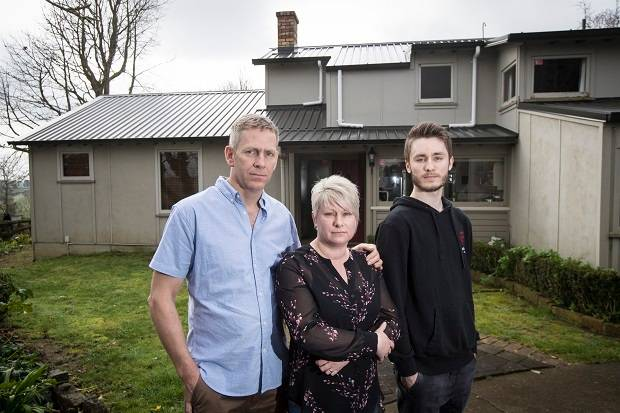 John, Sharon and Jordan Bailey outside their Pukekohe home which they claim was contaminated with asbestos after Pacific Decontamination Services removed the roof. Photo / Jason Oxenham