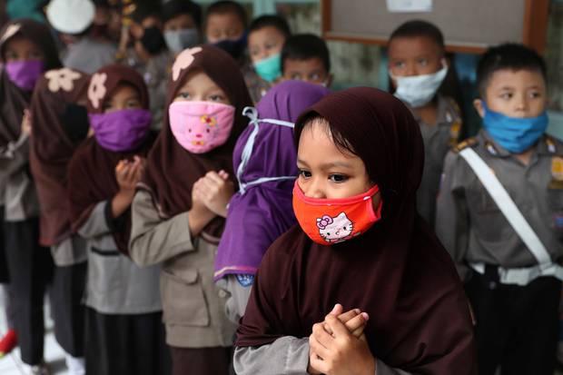 Children wear masks at a kindergarten in Jakarta, Indonesia. AP Photo / Tatan Syuflana