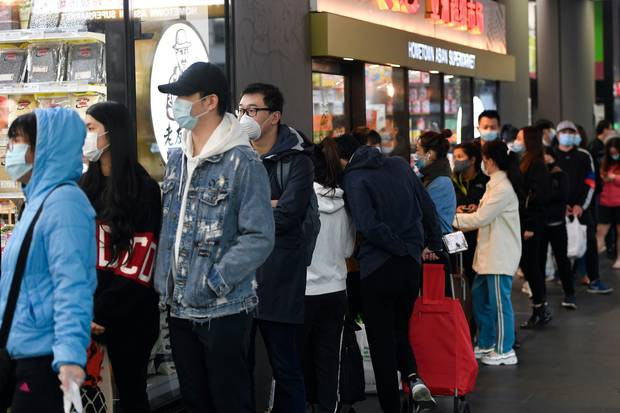 People line up to enter a supermarket hours before a citywide curfew is introduced in Melbourne, on August 2. Photo / AP