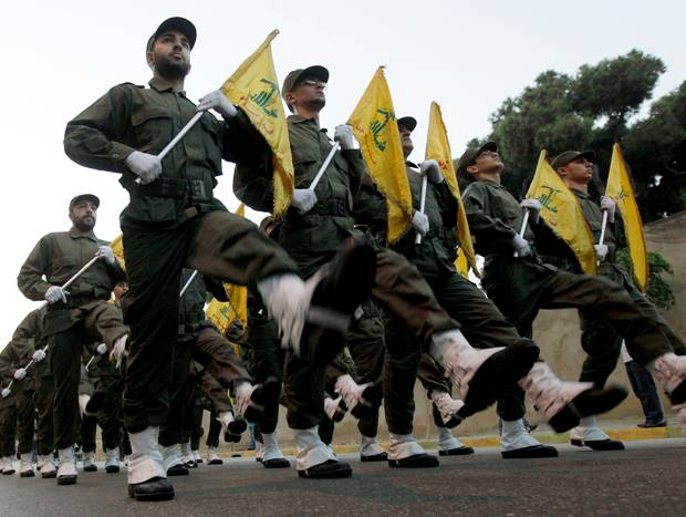 Hezbollah fighters parade during the inauguration of a new cemetery for their fighters. Photo / AP
