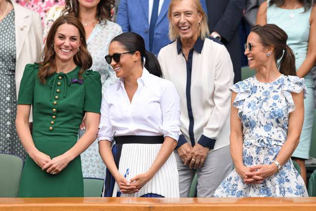 Three musketeers: Kate, Meghan and Pippa appeared to have a good time in the Royal Box. Former tennis champion Martina Navratilova was seated behind them. Photo / Getty