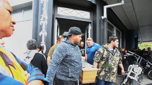 A large crowd of mourners gathered outside David Hart's tattoo studio, Native Ink, on Bank Street in an emotional farewell. Photo/ John Stone