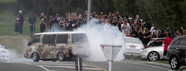 A van doing burnouts at the funeral. Photo / Alan Gibson