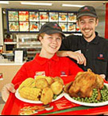 9347f7ed5de969 ... Julene Gunson and Ty Rix serve barbecue-roasted chicken at the new Red  Rooster restaurant