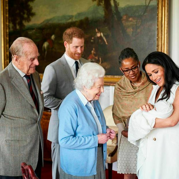 Britain's Prince Harry and Meghan, Duchess of Sussex, joined by her mother Doria Ragland, show their new son to Queen Elizabeth II and Prince Philip at Windsor Castle. Photo / AP