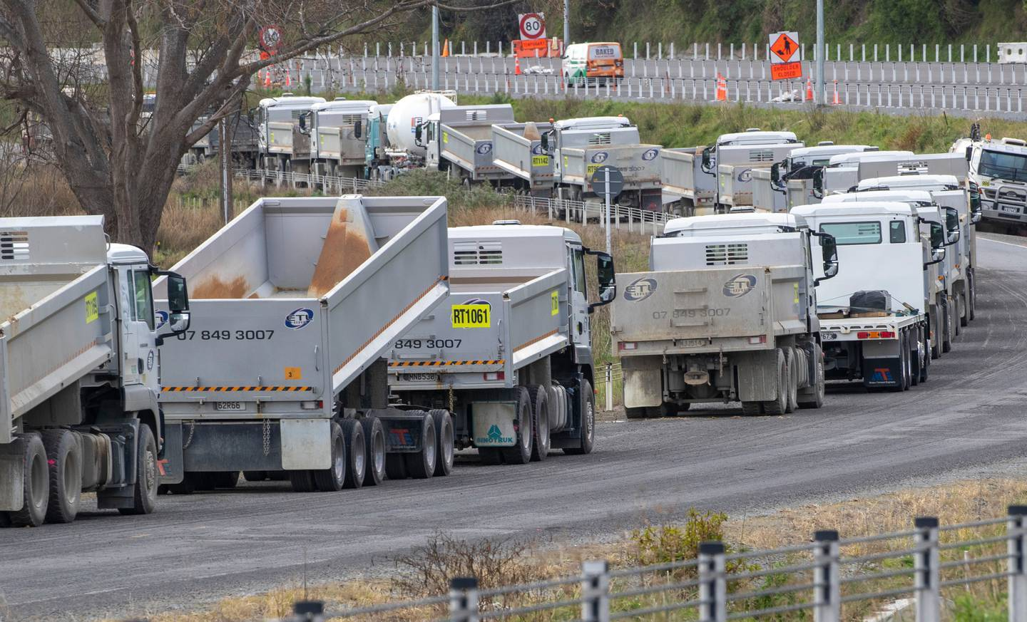 Truck and trailer units parked alongside a section of the Transmission Gully project on day three of lockdown. Photo / Mark Mitchell